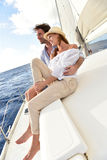 Recently married couple on a sailing cruise Stock Photography