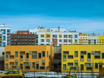 Recently populated modern residential block of apartments Stock Photos