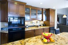 Recently Remodeled Kitchen. Shot of a recently remodeled kitchen featuting natural materials, cherry cabinets and beautiful granite royalty free stock image
