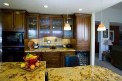 Recently Remodeled Kitchen. Shot of a recently remodeled kitchen featuting natural materials, cherry cabinets and beautiful granite royalty free stock photography