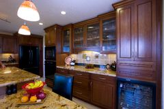 Recently Remodeled Kitchen. Shot of a recently remodeled kitchen featuting natural materials, cherry cabinets and beautiful granite Royalty Free Stock Images