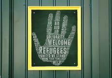 Recepción de los refugiados Imagenes de archivo