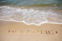 Recepción escrita en playa arenosa Foto de archivo libre de regalías