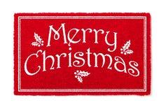 Recepción Mat Isolated del rojo de la Feliz Navidad en el fondo blanco fotografía de archivo libre de regalías