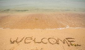 Recepción escrita en una playa arenosa Imagen de archivo libre de regalías