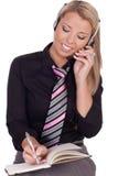 Recepcionista o secretaria que concierta una cita fotografía de archivo