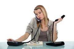 Recepcionista Overworked imagem de stock royalty free