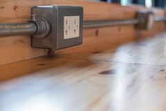 Receptacle made of metal, attached to a wooden. Surface Modern layout Like in a restaurant or coffee shop stock images