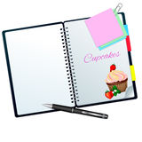 Receptbok ilustrated med jordgubbemuffin Arkivbilder