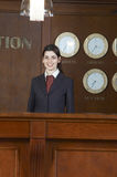 Reception. Young business lady work on reception Stock Photography
