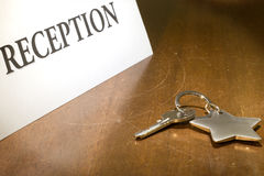 Reception. Close up of key on wooden reception desk Stock Photo