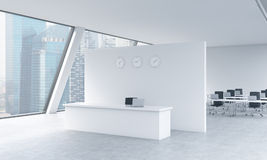 Reception area with clocks and workplaces in a bright modern open space loft office. White tables and black chairs. Singapore pano Stock Images