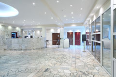 Reception area, glass entrance doors in office building Royalty Free Stock Images