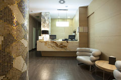 Reception area with marble reception desk Stock Image