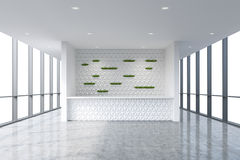 A reception area in a modern bright clean office interior. Huge panoramic windows with white copy space.  Stock Photo