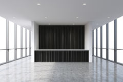 A reception area in a modern bright clean office interior. Huge panoramic windows with white copy space. A concept of boutique con Stock Images