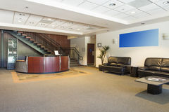Reception area. Spacious office lobby in office building stock photos