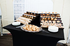 Reception with baking  at black table Stock Photos