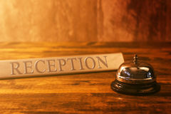 Reception bell at hotel check in desk Stock Photo