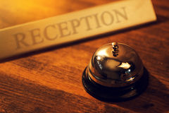 Reception bell at hotel check in desk Stock Photos