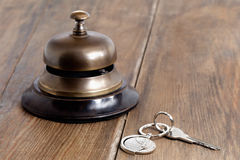 Reception bell and hotel key Royalty Free Stock Images