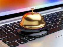 Reception bell on the laptop keyboard with soft focus Stock Image