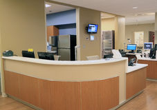 Hospital Reception Desk. Front Reception Desk with computer terminals and phones in commercial office, hospital, school or hotel royalty free stock images