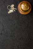Reception desk in hotel with ring and keys dark background top view space for text Royalty Free Stock Photography