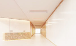 Reception desk in long sunlit corridor Stock Image