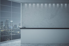 Reception desk and night city view. Empty reception desk in concrete interior with night city view. 3D Rendering royalty free illustration