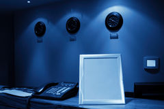 Reception desk with phone and clock Royalty Free Stock Images