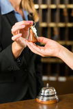 Reception - Guest checking in a hotel Stock Photos