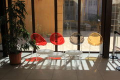 Reception hall interior. Some administrational or enterprise reception hall interior, with four colorful plastic chairs of modern design, a plant, bay windows on Royalty Free Stock Images