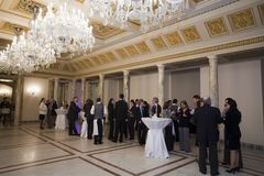 Reception hall - invited people socialize. Great salon reception. The living room of the royal palace - Romanian Royal Palace Royalty Free Stock Photo