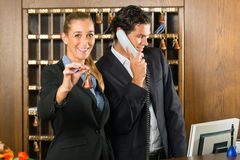 Reception in hotel - Man and woman Royalty Free Stock Photography