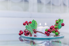 Reception Interior with candles and flowers on a mirror plate Royalty Free Stock Image