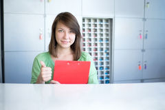Reception. Sales consultant with red folder in hands Stock Photo