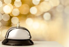 Reception service desk bell, close-up view. Bell service desk reception table background foreground Royalty Free Stock Photo