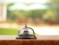 Reception service desk bell n blurred background. Bell service desk reception table background foreground Royalty Free Stock Image