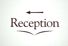 Reception sign. A reception sign with arrow - in a hotel wall Stock Photos