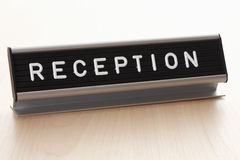 Reception sign on desk Stock Image