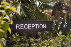 A reception sign in the garden of the hotel entry Royalty Free Stock Images