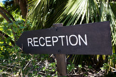 A reception sign in the garden of the hotel entry Stock Photography