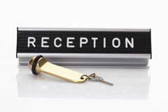 Reception sign with hotel key Royalty Free Stock Photos