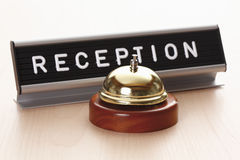 Reception sign with service bell on desk Stock Image