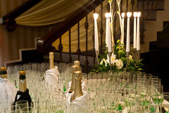 Reception table with white candles and glasses Stock Images
