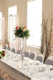 Reception tables. Table setting for wedding or anniversary reception with chair covers Stock Images