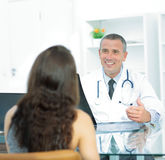 At the reception, the therapist discusses with the patient the r Royalty Free Stock Images
