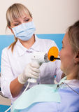 The reception was at the female dentist. Doctor examines the oral cavity on tooth decay. Royalty Free Stock Image