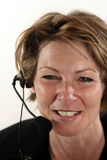 Receptionist. Woman with headset Stock Photography